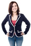 Stock Photo of Cheerful young woman posing confidently