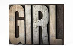 Retro sorts or printers blocks spelling - girl Stock Photos
