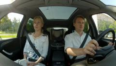 Office Man and woman ride in the car cabin by city route Stock Footage