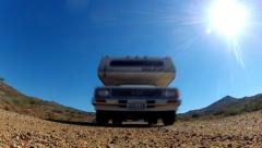 Toyota RV On Gravel Road Comes Straight Toward And Over Camera- Faster Stock Footage