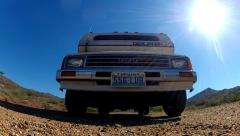 Toyota RV On Gravel Road Comes Straight Toward And Over Camera- Slower Stock Footage