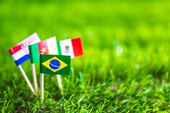 paper cut of flags on grass for soccer championship 20 - stock photo