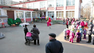 Stock Video Footage of Teachers go out groups of preschool kids from nursery, Russia