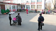 Stock Video Footage of Parents with preschool children meeting in nursery inner yard, Russia