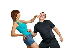 Girl beats her boyfriend Stock Photos