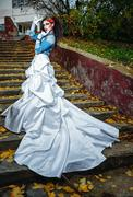 Bride on stairs - stock photo