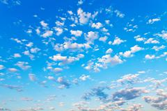 View of many little white clouds in blue sky Stock Photos