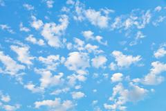 Lot of little white clouds in blue sky Stock Photos