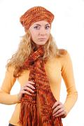 Woman in orange knitted hat, scar and sweater Stock Photos