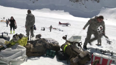 Soldiers setting up a base camp at Mount McKinley  Stock Footage