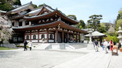 Timelapse of the walking people in the famous temple of Kamakura, Japan - stock footage