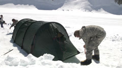 Soldiers putting up a tent at Mount McKinley Base Camp Stock Footage