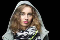 beautiful trendy woman in a hooded jacket - stock photo