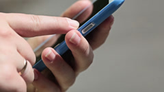 Woma's fingers touching and swiping the screen of a modern smartphone Stock Footage