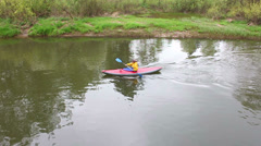The girl on a kayak sailing on the tranquil river Stock Footage