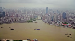 Timelapse of multiple barges sailing along river through Shanghai.  China Stock Footage