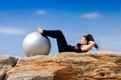 Pilates - Woman abdominal crunches Stock Photos
