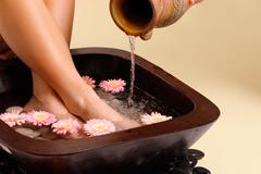 Soothing foot soak - stock photo