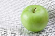 Stock Photo of green apple on a binary code