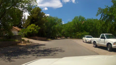 POV Driving Tree Lined Streets Of Small Town Village- Blue Diamond NV Stock Footage