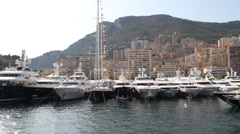 Superyachts Stationed in Monaco Harbor Stock Footage