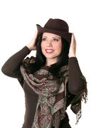 Happy female trying on a brown felt hat Stock Photos