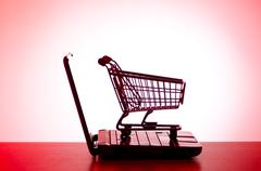 Stock Photo of Silhoette of shopping cart and laptop