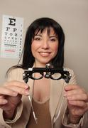 Optometrist eyesight checkup - stock photo