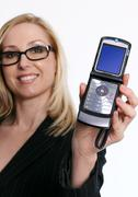 Famale holding an open flip cell phone - stock photo