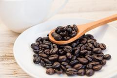 coffee beans on the white dishware - stock photo
