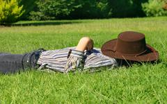 Child asleep in the grass Stock Photos
