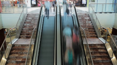 People rushing on escalator Stock Footage
