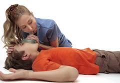 Resuscitating unconscious boy - stock photo