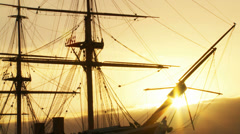 Golden light hits 19th century war ship Stock Footage