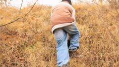 Young boy climbing on the hill Stock Footage