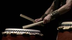Detail of the hands of a taiko drummer playing a japanese drum - stock footage