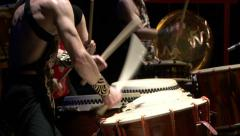 Stock Video Footage of Medium shot of arms and hands of three taiko drummers