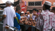 Stock Video Footage of Morocco, Marrakech. People buying bread from a vendor during Ramadan