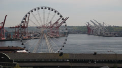 Ferris wheel in Seattle with Freight harbor in background 1 Stock Footage