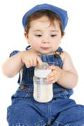Infant baby with milk bottle Stock Photos