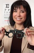 Optometrist holding trial frames Stock Photos