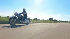 Biker riding harley motorbike follow shot Stock Footage