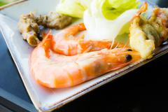 grilled shrimp on the plate - stock photo