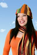 Cheerful optimistic woman in winter scarf and hat Stock Photos