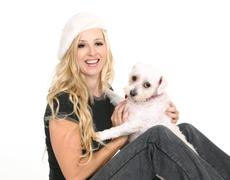 Female playing with a small dog - stock photo