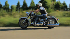 Biker riding harley motorbike follow shot Stock Footage