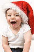 Jolly boy in santa hat Stock Photos