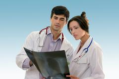 Two doctors conferring over x-ray results Stock Photos