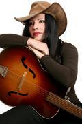 Maa nainen esiintyjä ja kitara Kuvituskuvat