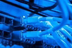 Network hub and patch cables Stock Photos